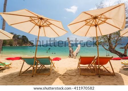Chairs and umbrellas on Paradise beach in Phuket island - stock photo
