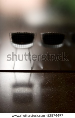 chairs behind frosted glass partition - stock photo