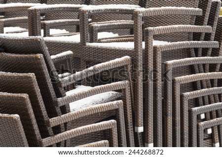 Chairs covered with snow - stock photo
