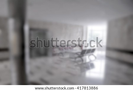Chairs in the hospital hallway. hospital interior blurred - stock photo