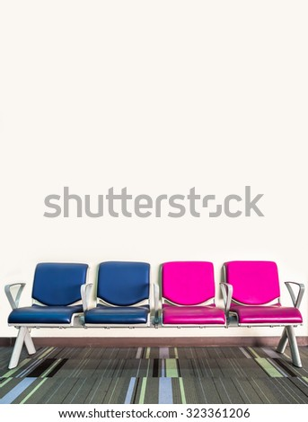 chairs in waiting room against a wall - stock photo