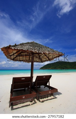 Chairs on a beautiful tropical island beach - stock photo