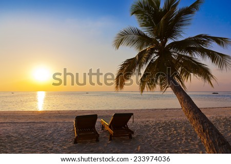 Chairs on Maldives beach - nature vacation background - stock photo