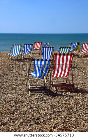 Chairs on pebbly beach - stock photo