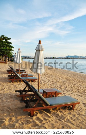 Chairs on the beach at evening time, Pattaya, Thailand - stock photo