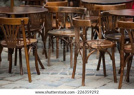 Chairs on the street of Lviv. Ukraine - stock photo