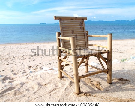 chairs on tropical beach - stock photo