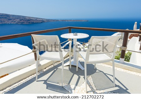 Chairs With Beautiful View To Relax in Santorini, Greece - stock photo