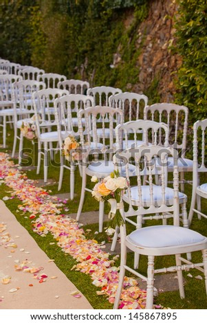 chairs with flowers arranged for wedding ceremony
