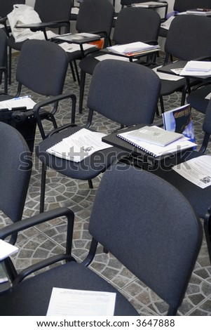 Chairs with papers in the classroom