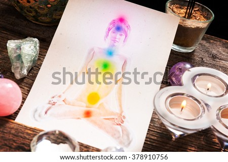 Chakras illustrated over human body with natural crystals  - stock photo