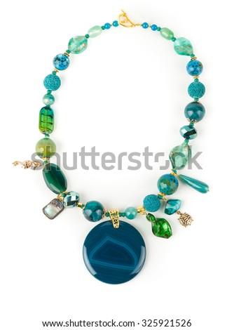 Chalcedony creative necklace set round on white background. - stock photo