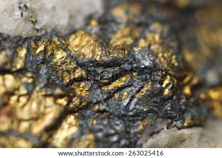 Chalcopyrite, It has the chemical formula (CuFeS2). Copper iron sulfide mineral. Macro. Beautiful fantastic background for successful business projects. - stock photo