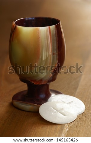 Chalice and communion wafers still life - stock photo