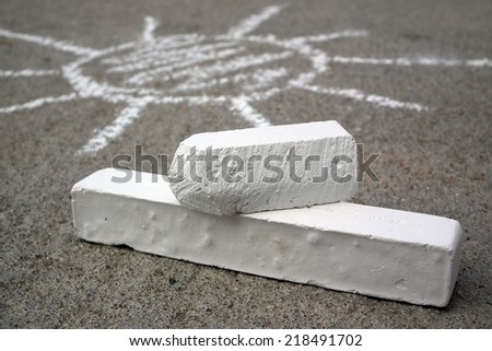 Chalk and drawing sun - stock photo