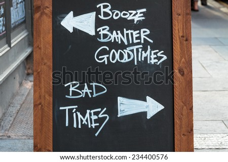 Chalk board in front of a pub with good times versus bad times - stock photo