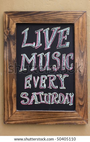 Chalk board sign indicating live music - stock photo