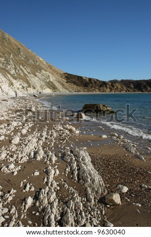 Chalk cliffs eroding in Dorset England. - stock photo