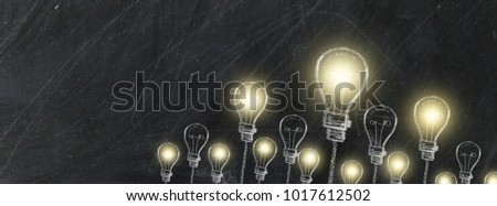 Chalk drawing bulb electric concept design on black background for website and timeline,Light bulbs and chalk board with copy space for text.