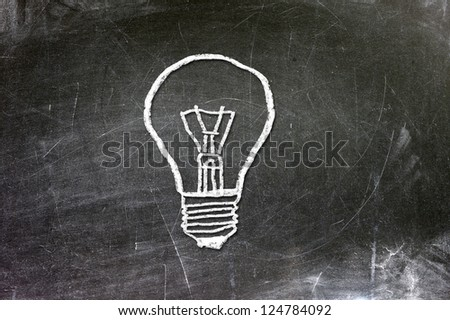 Chalk drawing of light bulb. Idea concept. - stock photo