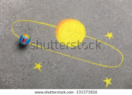 Chalk drawing of sun, stars and earth - stock photo