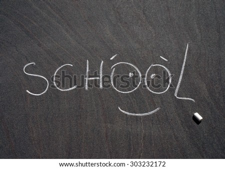 "chalk inscription ""school"" on a blackboard"