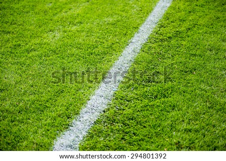 Chalk line on the football or soccer field - stock photo