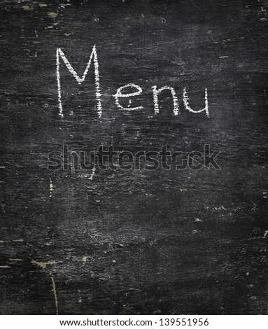 Chalk on black board: Menu - stock photo