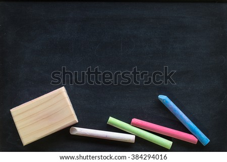 Chalk rubbed out on blackboard for background. Empty blank black chalkboard with chalk traces