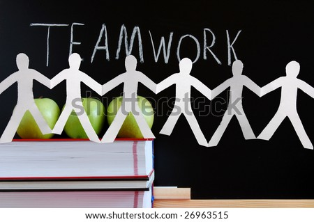 chalkboard and apples showing a concept for teamwork