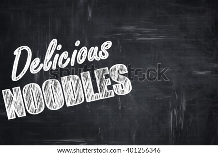 Chalkboard background with chalk letters: Delicious noodles sign