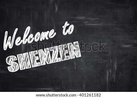 Chalkboard background with chalk letters: Welcome to shenzen
