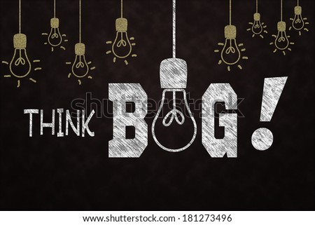 Chalkboard drawing of light bulbs and a reminder to think big. - stock photo