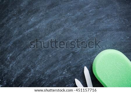 chalkboard in classroom background with sponge chalk eraser - stock photo