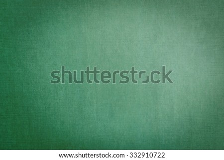 Chalkboard texture background in green color tone: Grunge school blackboard textured pattern backdrop with blank empty copy space for writing message or teacher announcement in green toned colour - stock photo