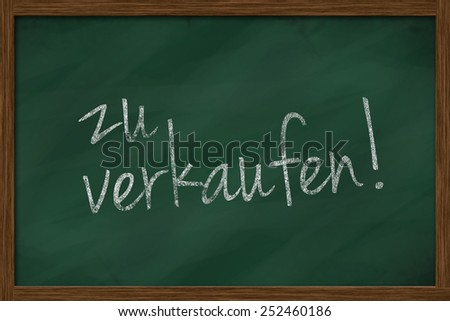 chalkboard with german text zu verkaufen, which means for sale