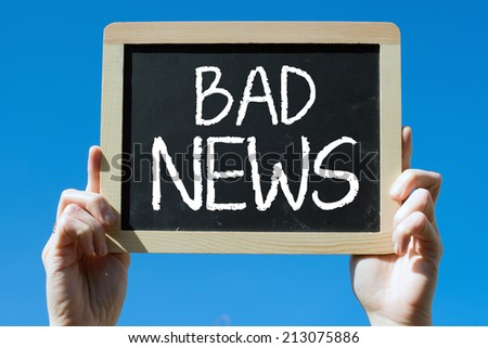 Chalkboard with Hands with text bad news - stock photo