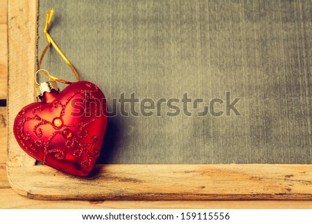 Chalkboard with heart shape Christmas ornament - stock photo