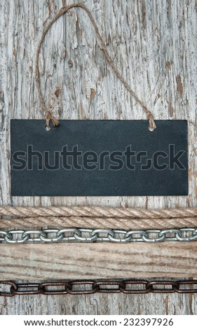 Chalkboard with metal chain on the old wood  - stock photo