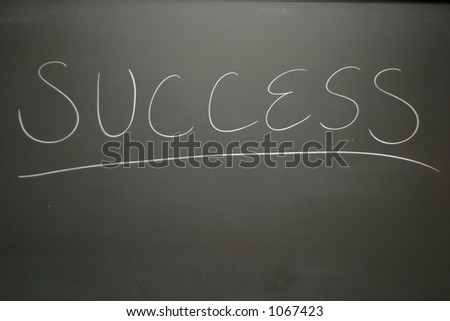 Chalkboard with success written - stock photo
