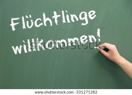 Chalkboard with the german words Refugees Welcome / Refugees Welcome - stock photo
