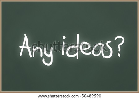 Chalkboard with wooden frame and the text Any Ideas? - stock photo