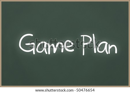 Chalkboard with wooden frame and the text Game Plan - stock photo