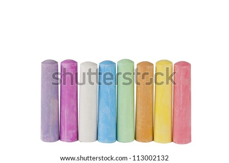 chalks in a variety of colors arranged on a white background - stock photo