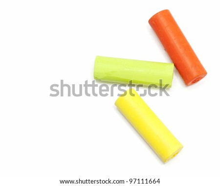 chalks in a variety of colors arranged on a white background, space for text on the left - stock photo