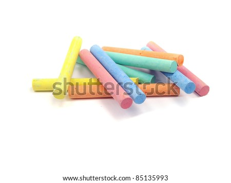 chalks in a variety of colours arranged on a white background