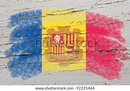 Chalky andorran flag painted with color chalk on grunge wooden texture - stock photo