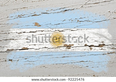 Chalky argentinian flag painted with color chalk on grunge wooden texture - stock photo