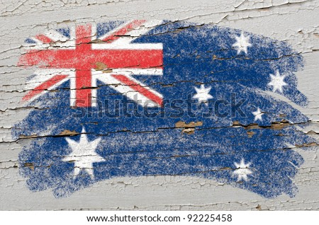 Chalky australian flag painted with color chalk on grunge wooden texture - stock photo