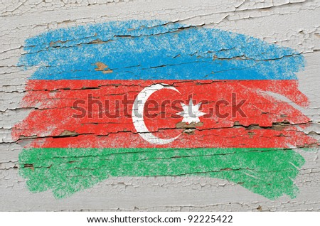 Chalky azerbaijan flag painted with color chalk on grunge wooden texture - stock photo